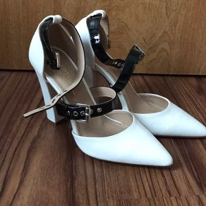 double buckle white and black pumps